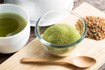 powdered green tea on bamboo napkin texture