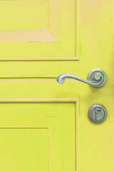classic door handle on yellow door