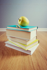 Textbook with yellow apple