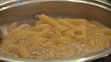 Cooking Penne (in a pot) as 4K UHD close-up footage