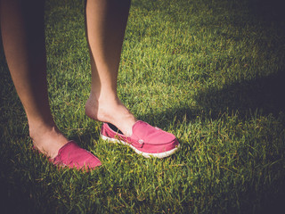 Pink casual shoes on girl, with retro filter effect