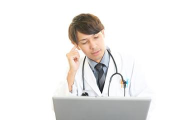 頭痛を訴える医師