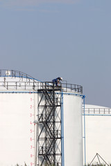 workers standing on oil tank