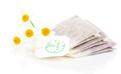 bags of chamomile tea with fresh camomile flower, isolated on wh