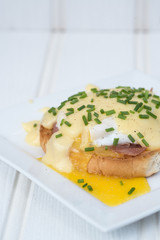 Eggs Benedict toasted English muffins ham poached eggs and holla