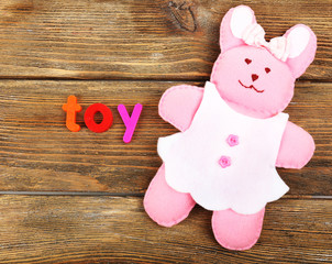 Toy word formed with colorful letters on wooden background