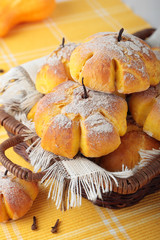 Basket of buns with pumpkin, cinnamon and cloves