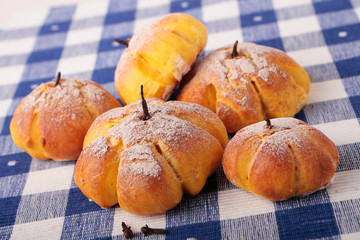Buns with pumpkin on checkered napkin