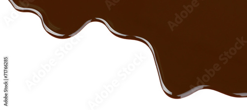 Melted chocolate dripping on white background - 71766285