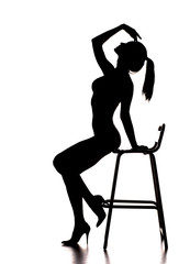 silhouette of pretty stripper on a chair