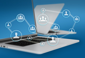 Group of people icons connected to network and laptops in the