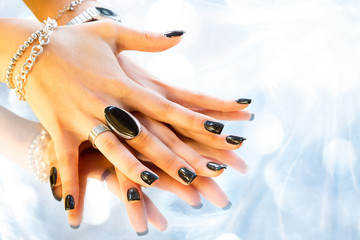 dark manicure with silver bijoux