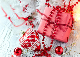 Christmas red present box with a heart shape decoration