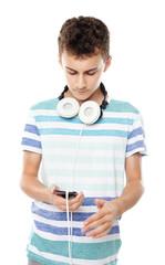 Teenager listening music on headphones