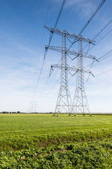 Power lines and pylons in a rural landscape