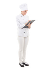 full length portrait of young woman in chef uniform writing some