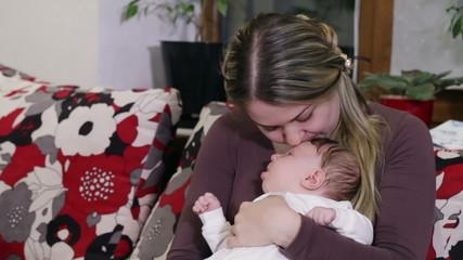 Mom kissing baby