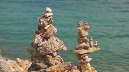 Steady stones on sea background