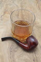 smoking pipe and whiskey