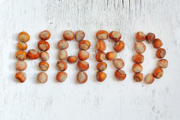 inscription hard made of hazelnuts