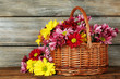 canvas print picture - Beautiful chrysanthemum in basket on wooden background