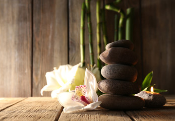 Spa stones, white orchid and bamboo branches
