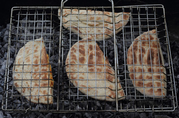 Roasted arabic bread pita on the grill