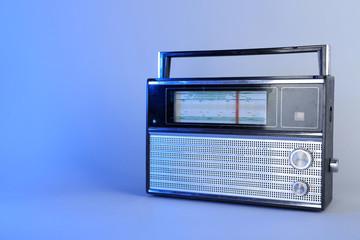 Old radio set on blue background