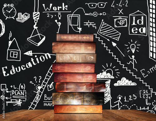 stack of old books on the background painted whiteboards - 71772601