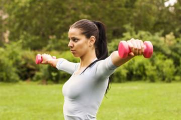 Girl exercising in the park