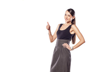 happy young woman showing thumb up on a white background