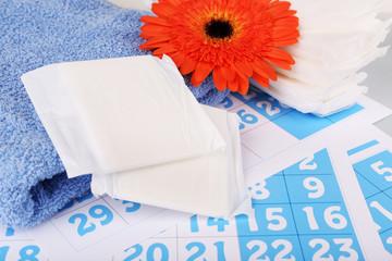Sanitary pads, orange Gerber and towel