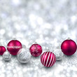 Silver background with magenta christmas balls.
