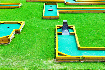 Mini-Golf field in summer day. Green course.