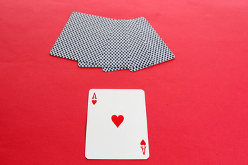 Individuality concept. Playing cards on red background