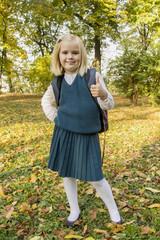 schoolgirl walks in the park