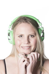 young blond girl with headphones