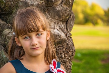 Portrait of a beautiful little girl with big gray eyes