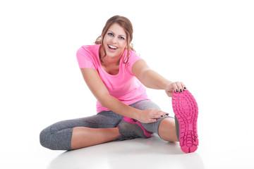Junge hübsche Frau macht Sport und ist glücklich