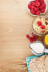 Healthy breakfast with muesli, berries and milk