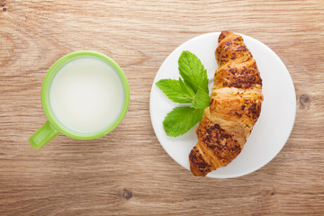 Milk and fresh croissant
