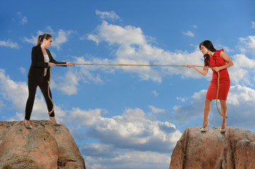 Businesswomen in Tug of War