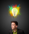 Businessman thinking with lightbulb above his head