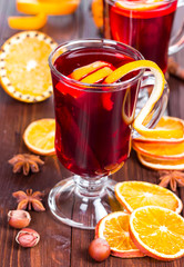 Hot mulled wine on a wooden background