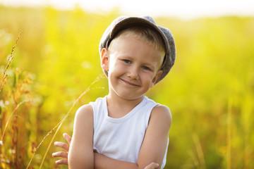 Happy little boy in a gray cap