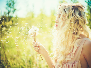 Beautiful blonde with dandelions