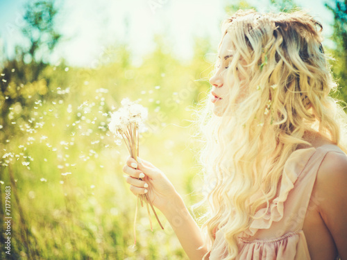 Beautiful blonde with dandelions - 71779683