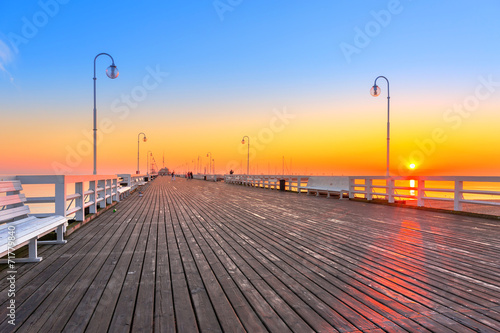 Sunrise at wooden pier (molo) in Sopot, Poland