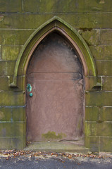 old metal door to a crypt