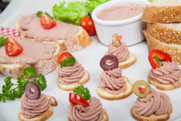 platter with slices of bread with home made pate with vegetables